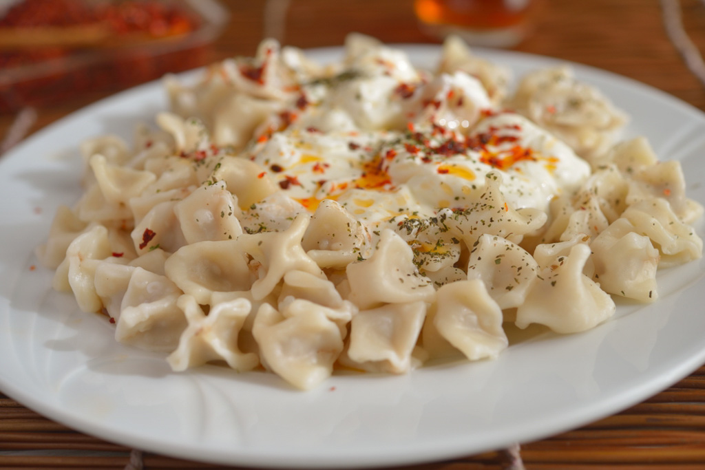Turkish Dumplings Manti. Manti is a tiny pastry filled with meat, boiled in water and served with a yogurt sauce.